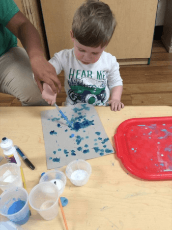 2-year-old_boy_doing_eye_dropper_art_cadence_academy_preschool_east_greenwich_ri-338x450