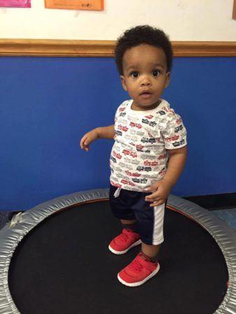 2-year-old_boy_on_trampoline_at_cadence_academy_preschool_surfside_myrtle_beach_sc-338x450