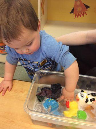 2-year-old_boy_playing_with_plastic_animals_growing_kids_academy_fredericksburg_va-336x450