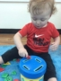 2-year-old_doing_button_sorting_activity_at_cadence_academy_preschool_west_bridgewater_ma-338x450