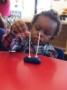 2-year-old_doing_cheerio_activity_at_cadence_academy_preschool_northeast_columbia_sc-336x450