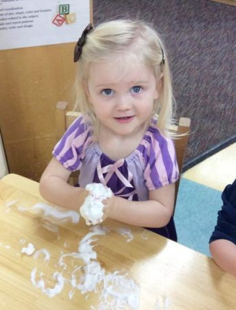 2-year-old_girl_doing_playdough_activity_carolina_kids_child_development_center_fort_mill_sc-343x450