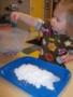 2-year-old_girl_enjoying_glitter_art_project_cadence_academy_preschool_sherwood_or-338x450