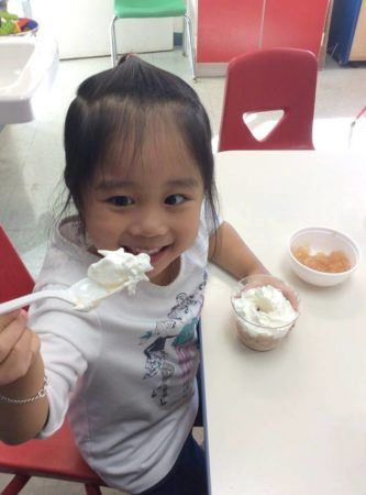 2-year-old_girl_excited_about_snack_growing_kids_academy_fredericksburg_va-333x450