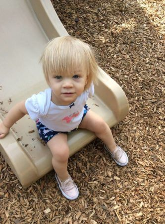 2-year-old_girl_going_down_slide_winwood_childrens_center_gainesville_ii_va-333x450