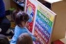 2-year-old_girl_identifying_day_of_the_week_cadence_academy_preschool_sherwood_or-675x450