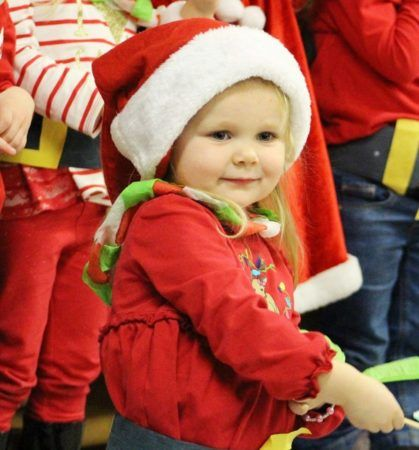 2-year-old_girl_in_santa_hat_at_cadence_academy_preschool_lexington_sc-419x450