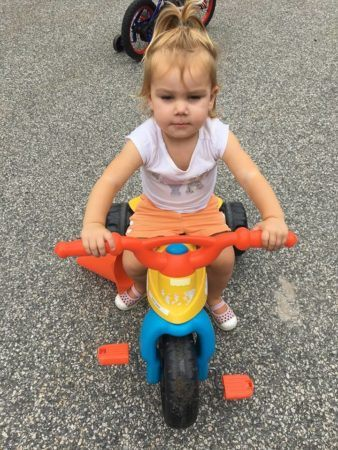 2-year-old_girl_on_tricycle_jonis_child_care_preschool_canton_ct-338x450