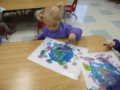2-year-old_girl_painting_at_cadence_academy_preschool_louisville_ky-599x450