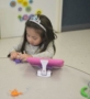 2-year-old_girl_playing_with_plastic_frog_winwood_childrens_center_fairfax_va-409x450