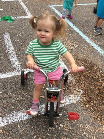 2-year-old_girl_riding_tricycle_at_next_generation_childrens_centers_walpole_ma-336x450