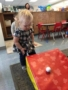 2-year-old_girl_rolling_ball_down_ramp_jonis_child_care_preschool_canton_ct-338x450