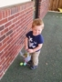 2-year-old_hunting_for_easter_eggs_cadence_academy_northlake_charlotte_nc-338x450