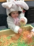 2-year-old_in_costume_playing_with_yarn_next_generation_childrens_centers_hopkinton_ma-333x450