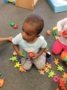 2-year-old_playing_with_gingerbread_mean_and_turtles_cadence_academy_preschool_greensboro_nc-336x450