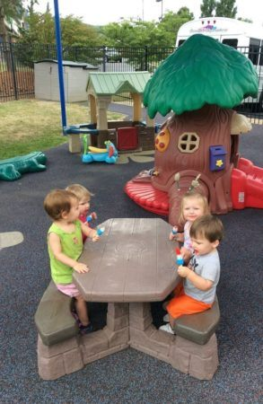 2-year-olds_eating_bomb_pops_on_playground_creative_expressions_learning_center_eureka_mo-293x450