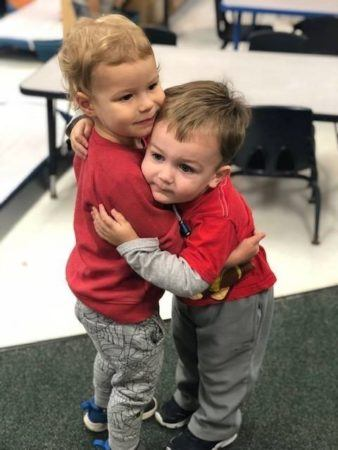 2-year-olds_hugging_winwood_childrens_center_reston_va-338x450