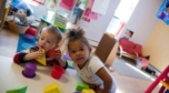 2-year-olds_playing_with_stackable_shapes_cadence_academy_preschool_norwood_ma-752x418