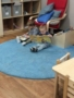 2-year-olds_reading_books_on_rug_at_cadence_academy_preschool_west_bridgewater_ma-338x450