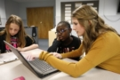 after_school_teacher_helping_elementary_student_with_homework_winwood_childrens_center_leesburg_va-675x450