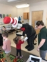 cat_in_the_hat_holding_hands_withpreschool_girl_cadence_academy_preschool_crestwood_ky-338x450
