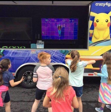 children_playing_dance_game_on_trailer_growing_kids_academy_fredericksburg_va-446x450