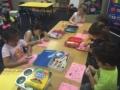 coloring_with_markers_at_cadence_academy_preschool_dallas_tx-600x450