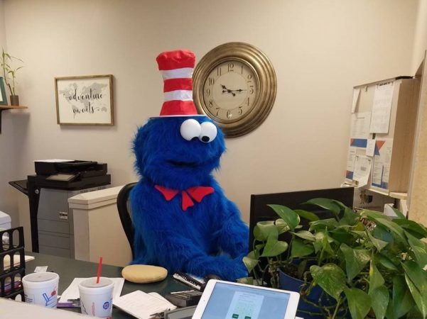 cookie_monster_working_front_desk_canterbury_preparatory_school_overland_park_ks-601x450