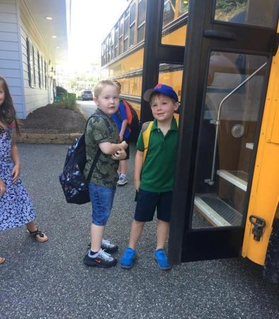 elementary_children_getting_on_bus_to_school_jonis_child_care_preschool_burlington_ct-394x450