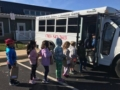 elementary_school_students_taking_bus_to_school_winwood_childrens_center_brambleton_ii_va-599x450