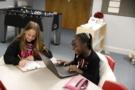 elementary_students_having_fun_while_doing_homework_winwood_childrens_center_leesburg_va-675x450
