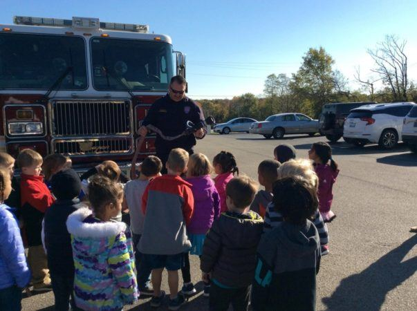 firefighter_showing_hose_to_preschoolers_at_cadence_academy_preschool_crestwood_ky-603x450