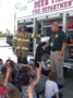 fireman_answering_questions_about_fire_truck_at_the_peanut_gallery_la_porte_tx-336x450