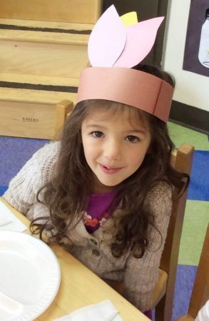 girl_celebrating_thanksgiving_at_carolina_kids_child_development_center_fort_mill_sc-293x450