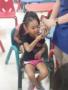 girl_petting_snake_cadence_academy_preschool_greensboro_nc-338x450
