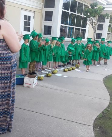 graduate_excited_to_get_her_diploma_pre-kindergarten_graduation_canterbury_preparatory_school_overland_park_ks-370x450
