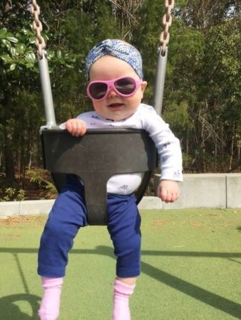 infant_girl_in_swing_at_cadence_academy_preschool_charleston_sc-338x450