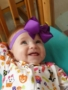infant_smiling_in_crib_at_cadence_academy_preschool_harbison_columbia_sc-338x450