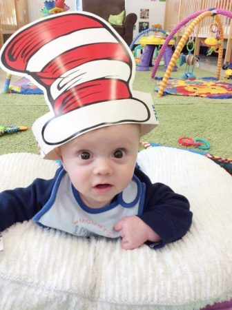 infant_wearing_cat_in_the_hat_gateway_academy_mckee_charlotte_nc-336x450