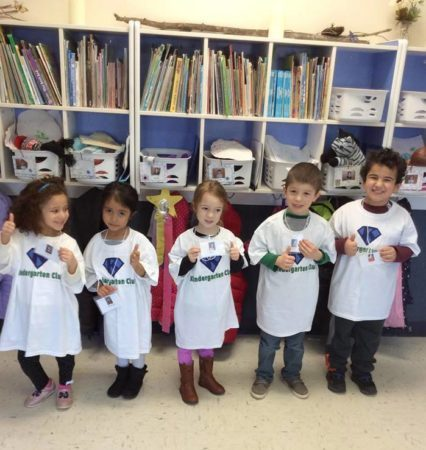 kindergarten_club_students_showing_off_their_nametags_winwood_childrens_center_ashburn_va-426x450
