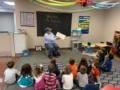 mailman_reading_book_to_class_jonis_child_care_preschool_burlington_ct-600x450