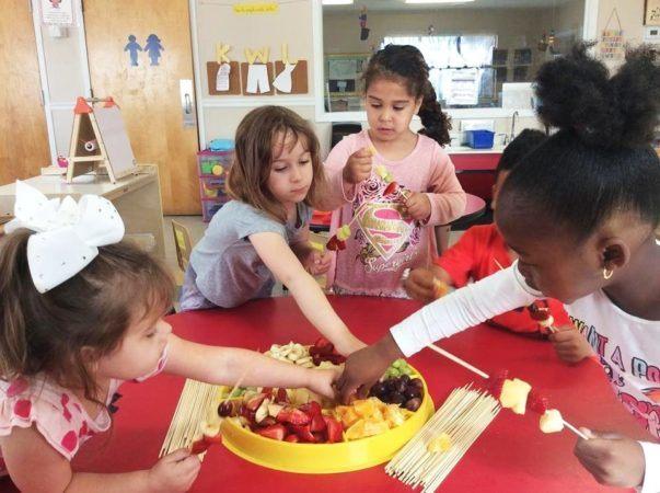 making_fruit_kebobs_cadence_academy_preschool_surfside_myrtle_beach_sc-603x450