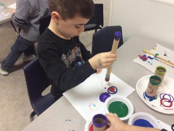 painting_with_cardboard_tubes_cadence_academy_preschool_urbandale_ia-600x450