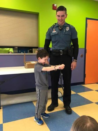 police_officer_arresting_preschooler_creative_expressions_learning_center_eureka_mo-338x450