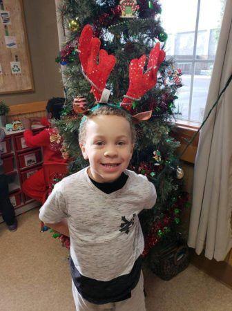 pre-kindergarten_boy_in_reindeer_antlers_cadence_academy_preschool_portland_or-336x450