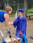 pre-kindergarten_girl_receiving_her_diploma_winwood_childrens_center_ashburn_va-339x450