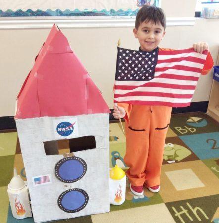 preschool_astronaut_with_american_flag_cadence_academy_preschool_myrtle_beach_sc-442x450
