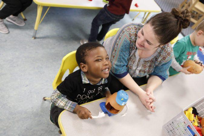 preschool_boy_and_teacher_laughing_together_winwood_childrens_center_leesburg_va-675x450