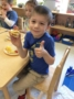 preschool_boy_enjoying_breakfast_burrito_winwood_childrens_center_ashburn_va-336x450