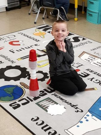 preschool_boy_enjoying_stem_activity_prime_time_early_learning_centers_east_rutherford_nj-338x450